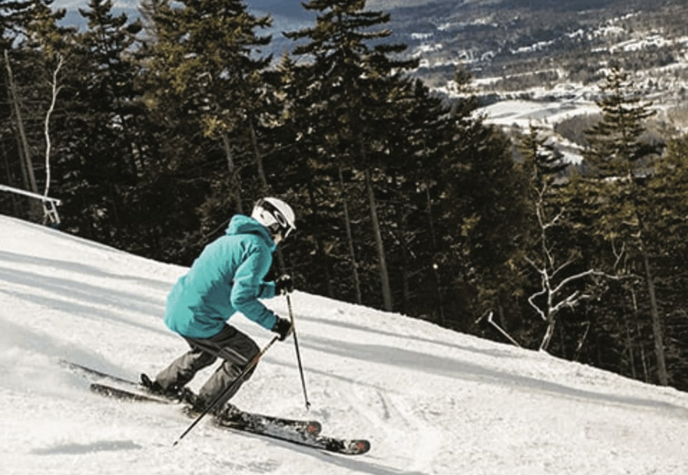 A skier going downhill at Loon Mountain